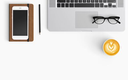 Modern workspace with coffee cup, smartphone, paper, notebook, tablet and laptop copy space on white color background. Top view. Flat lay style. 스톡 콘텐츠