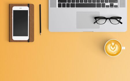 Modern workspace with coffee cup, notebook, smartphone, blank paper and laptop copy space on orange color background. Top view. Flat lay style. 스톡 콘텐츠