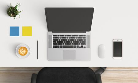 Modern workplace with laptop and smartphone copy space on white table background. Top view. Flat lay style.