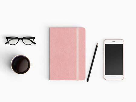 Modern office desk workplace with notebook diary, coffee cup, pencil and smartphone copy space on white desk background. Top view. Flat lay style.
