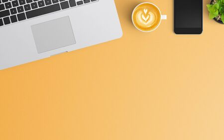 Modern workspace with coffee cup, smartphone and laptop copy space on orange color background. Top view. Flat lay style.
