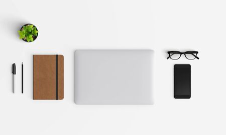 Modern workplace with notebook or laptop, coffee cup and smartphone copy space on color background. Top view. Flat lay style. 스톡 콘텐츠