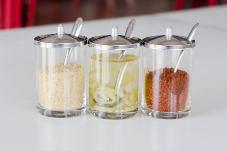 Various seasoning in glass for thai food photo