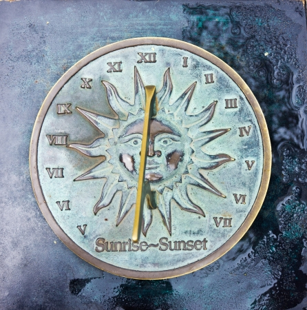 old sun clock dial in a garden Stock Photo