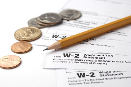 owe: Tax return papers, pencil and money on the white background Stock Photo