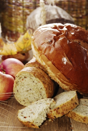 Different kinds of bread  on the wooden table photo
