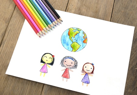 Children of different nationalities and Earth picture on the wooden table