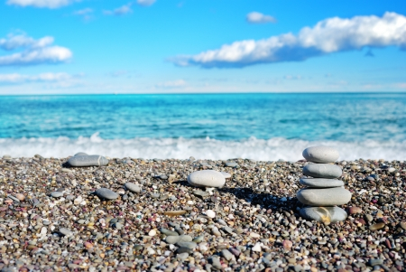 Beautiful view on the beach and column of sea stones