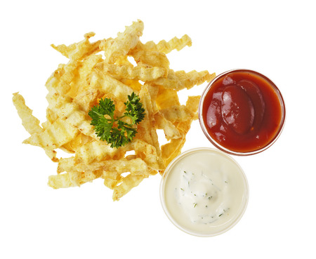sause: Fresh tasty french fries on the white isolated background with two kinds of sauce Stock Photo