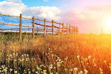 Fence in the green field under blue cloud sky. Beautiful landscape  photo