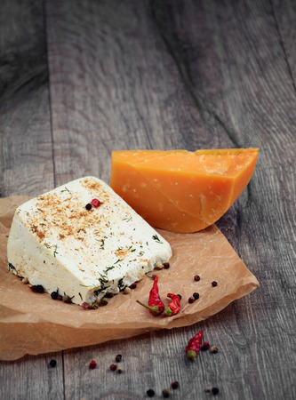 Two kinds of cheese  on the wooden table photo