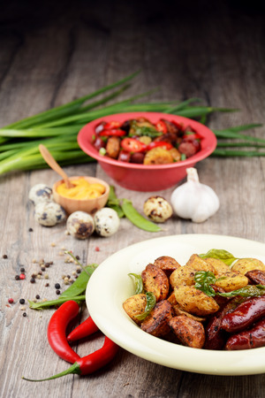 potatos: New roasted baked potato in the bowl with vegetables Stock Photo