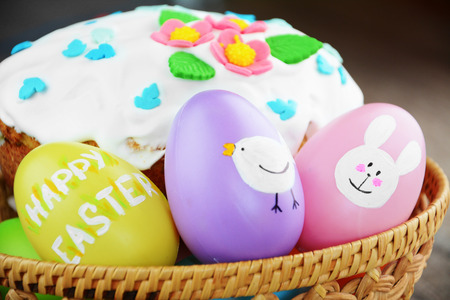 Sweet easter cake and eggs on the table Stock Photo
