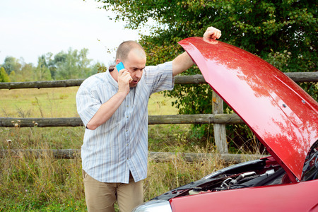 inconvenience: Adult man is calling to support near his broken car