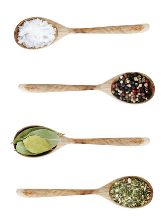 Different kinds of seasoning in the spoons Stock Photo