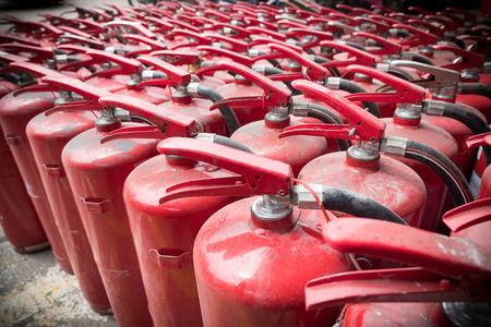 A lot of old fire extinguishers. Concept of protection and security Stock Photo
