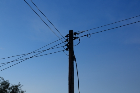 Energy and technology, electrical post with power line cables  photo