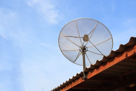 Satellite dish on the roof with blue sky   photo