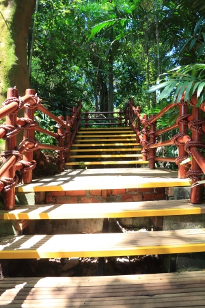 Yellow wooden staircase of resort  photo