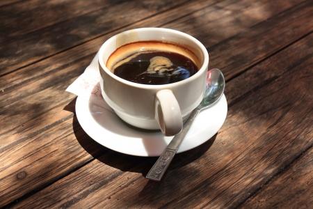 americano: Coffee Cup, Hot Americano Coffee on a Table  Stock Photo