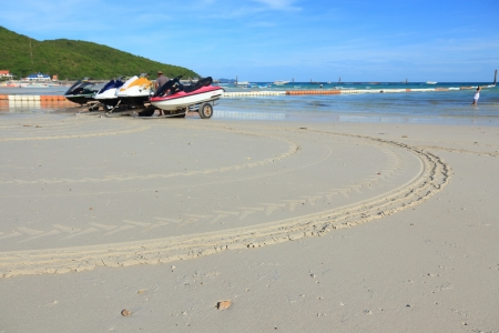 Track Wheel of Jet Ski on the Sand. photo