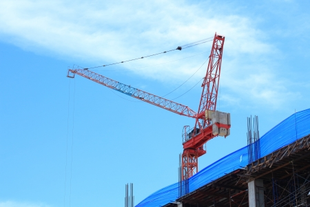 Buildings under Construction and Cranes under a Blue Sky  photo