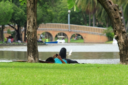Man Relaxing in Park  photo