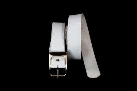Belt White Color Isolated on Black Background  photo