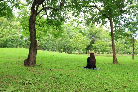 Woman Sitting in Park  photo
