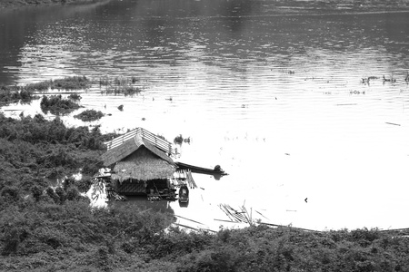 Black and White of Floating House at Kanchanaburi in Thailand  photo