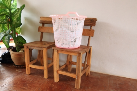 Clothes in White Plastic Basket  photo