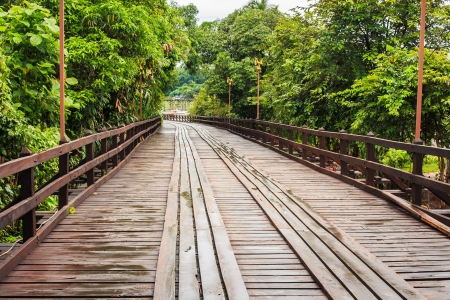 Closeup of the Longest Wooden Bridge at Songkalia River, Thailand  photo