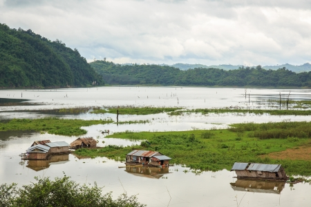 Many Raft Houses on the Songkalia River in Thailand  photo