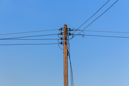 Energy and Technology, Electrical Post with Power Line Cables Stock fotó - 25030699