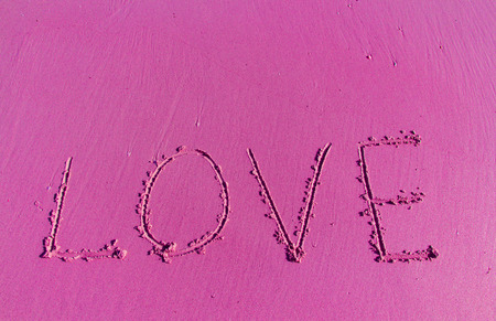 valentine s day beach: The Inscription on the Sand near the Sea - Pink LOVE