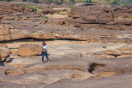 unruffled: Woman Taking a Photo at Stone Park