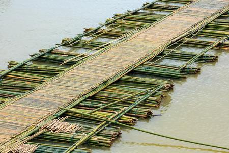 long tailed boat: Bamboo bridge across the river in Sangkhlaburi kanchanaburi Province Asia Thailand  Stock Photo