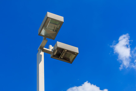 lights on: streetlight with blue sky. Stock Photo