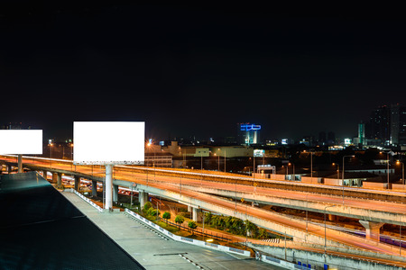 Blank billboard at night for advertisement.