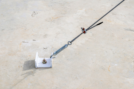Cement strong anchor connect with slings. photo
