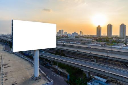 raod: Blank billboard at twilight for advertisement. Stock Photo