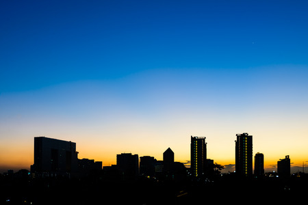 Silhouette building in Bangkok at sunset. photo