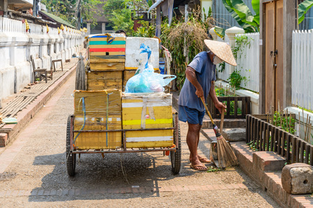 clean street: Man clean the street.