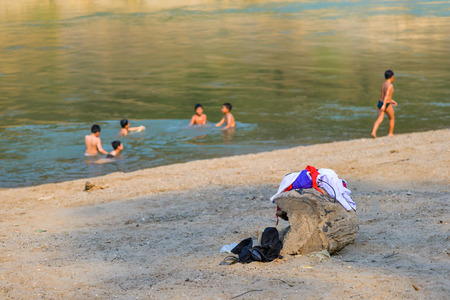 naked child: Children clothes while swimming at river near them school.