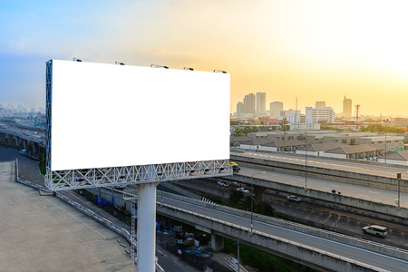 advertisement: Blank billboard at twilight for advertisement. Stock Photo