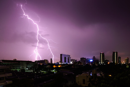 lightning storm: Strike of lightning into building in city. Stock Photo