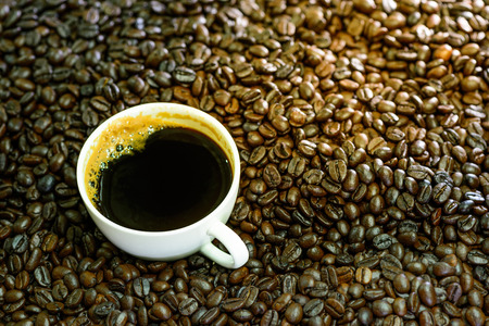 americano: Hot americano, Black coffee in white cup with coffee beans on sack backgrond.