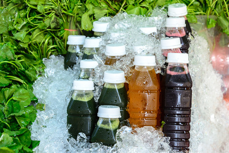 asiatic: Asiatic juice, Chrysanthemum juice and Roselle juice in bottle on ice with asiatic leaf. Stock Photo