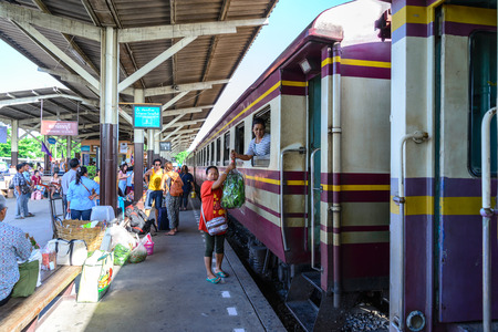 tranfer: BANGKOK - July 11: Unidentified woman monger deliver vegetables by rail freight on July 11, 2015 in Bangkok, Thailand.