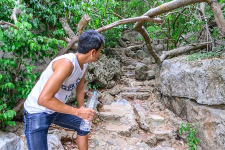 looking ahead: Man hiker looking ahead atfer drinking water in roasting day. Stock Photo